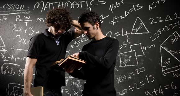 Students in front of a chalkboard.